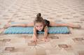 Little girl doing leg-split on the floor - PhotoDune Item for Sale