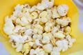 Tasty popcorn in yellow paper bag - PhotoDune Item for Sale