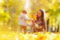 Mother and daughter in autumn park - PhotoDune Item for Sale