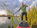 stand up paddling on a lake - PhotoDune Item for Sale