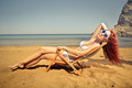 Beauty sunbathing at the beach - PhotoDune Item for Sale