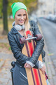 Pretty Woman in Trendy Attire Embracing Skateboard - PhotoDune Item for Sale