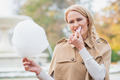 Pretty blond woman eating candy floss - PhotoDune Item for Sale