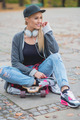 Cute trendy woman relaxing with her skate board - PhotoDune Item for Sale