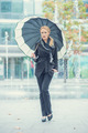 Young woman walking with an open umbrella - PhotoDune Item for Sale