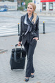 Young businesswoman with a suitcase - PhotoDune Item for Sale