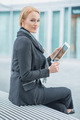 Corporate Woman Holding Tablet Outside Office - PhotoDune Item for Sale