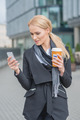 Businesswoman Busy with Phone While Having Coffee - PhotoDune Item for Sale
