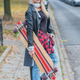 Trendy young woman carrying a skate board - PhotoDune Item for Sale
