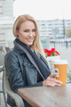 Attractive woman sitting drinking coffee - PhotoDune Item for Sale