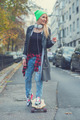 Cute young urban woman using a skate board - PhotoDune Item for Sale
