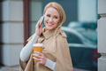Attractive woman taking a call on her mobile - PhotoDune Item for Sale