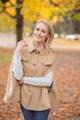 Smiling Pretty Woman in Brown Fashion Outfit - PhotoDune Item for Sale