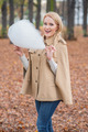 Cute stylish woman eating candy floss - PhotoDune Item for Sale