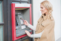 Pretty blond woman drawing money at an ATM - PhotoDune Item for Sale