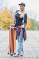 Gorgeous trendy blond woman with a skate board - PhotoDune Item for Sale