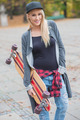 Cool Pretty Woman Holding Skateboard - PhotoDune Item for Sale