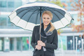 Smiling young woman under an open umbrella - PhotoDune Item for Sale