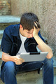 Sad Teenager with Tablet Computer - PhotoDune Item for Sale