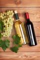 Red and white wine bottles and bunch of grapes - PhotoDune Item for Sale