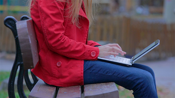 Woman Working on the Laptop in the Park