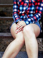 young girl is sitting on the stairs outdoors - PhotoDune Item for Sale