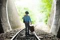 Child walking on railway road - PhotoDune Item for Sale