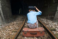 Child in vintage clothes sits on railway road - PhotoDune Item for Sale