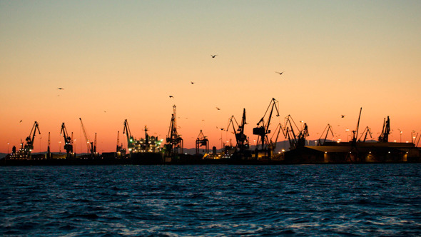Dock With Cranes In The Evening