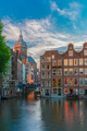 Evening city view of Amsterdam canal, church and bridge - PhotoDune Item for Sale