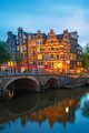 Night city view of Amsterdam canal and bridge - PhotoDune Item for Sale