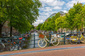 City view of Amsterdam canal, bridge and bicycles, Holland, Neth - PhotoDune Item for Sale