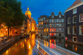 Night city view of Amsterdam canal, church and bridge - PhotoDune Item for Sale