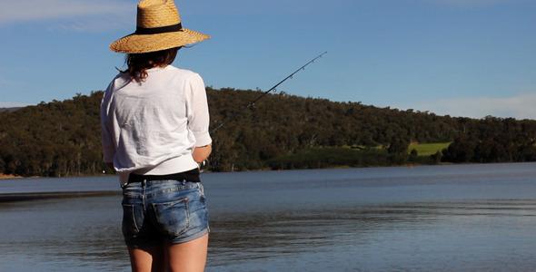 Girl Fishing On The Lake
