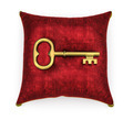 Golden key on royal red velvet pillow isolated on white backgrou - PhotoDune Item for Sale