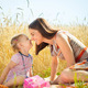 Happy young mother with little daughter on field in summer day - PhotoDune Item for Sale