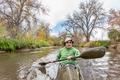 paddling sea kayak on a river - PhotoDune Item for Sale