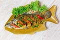 fried fish with fresh herbs and sweet spicy sauce on plate over - PhotoDune Item for Sale