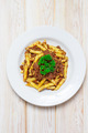 Penne pasta with a tomato bolognese beef sauce on wood table top - PhotoDune Item for Sale