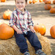 Cute Mixed Race Young Boy Having Fun at the Pumpkin Patch. - PhotoDune Item for Sale