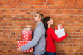 Smiling Couple Holding Gifts in Back to Back - PhotoDune Item for Sale