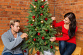 Sweet Young Couple Decorating Christmas Tree - PhotoDune Item for Sale