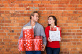 Happy Young Couple Holding Christmas Presents - PhotoDune Item for Sale