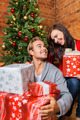 Sweet Young Couple Holding Christmas Gifts - PhotoDune Item for Sale