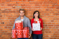 Frowning Lovers Holding Christmas Gifts - PhotoDune Item for Sale
