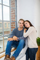 Relaxed young couple sitting in font of a window - PhotoDune Item for Sale