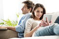 Couple surfing the net at home - PhotoDune Item for Sale