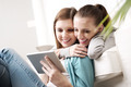Happy lesbian couple with tablet - PhotoDune Item for Sale