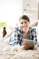 Woman relaxing at home with tablet - PhotoDune Item for Sale