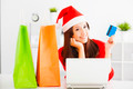 beautiful young woman holding credit card with laptop. Christmas shopping concept. - PhotoDune Item for Sale